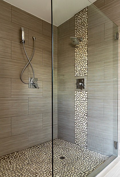 Wide SSI Walk-In frameless shower enclosure with heavy duty wall brackets, installed in a wet room luxury bathroom in London