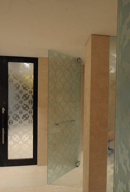 SSI True frameless shower door to ceiling in frosted glass with acid etched pattern on glass.