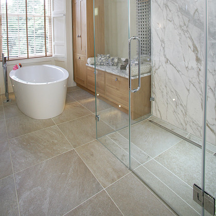 SSI Frameless glass enclosures with seamless finish to floor, no floor channels required