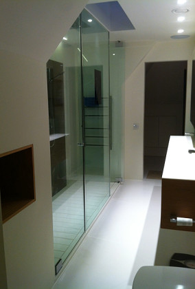 SSI True Frameless shower enclosure to ceiling. Frameless doors have offset pivot hinges.