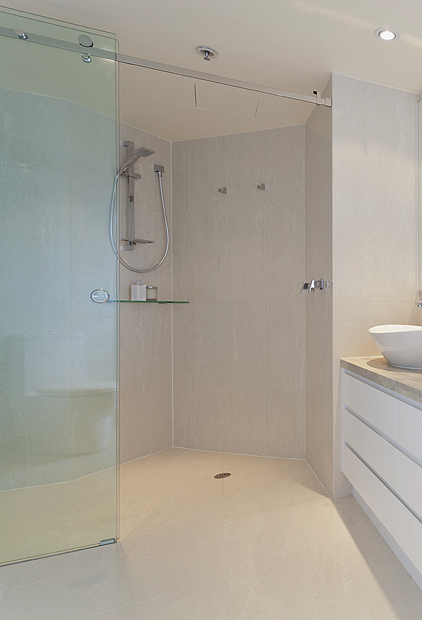 A Luxury wet room bathroom with an SSI True Frameless niche sliding enclosure installed.