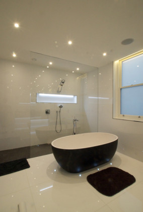 SSI Walk-In frameless shower enclosure to ceiling with recess ceiling channel, installed in a luxury wet room bathroom in London