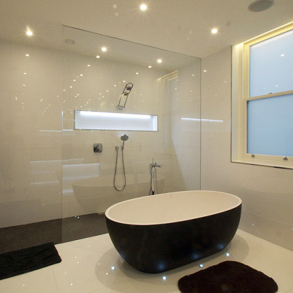 large SSI Walk-In frameless shower enclosure, recess ceiling channel, installed in a luxury wet room bathroom in London