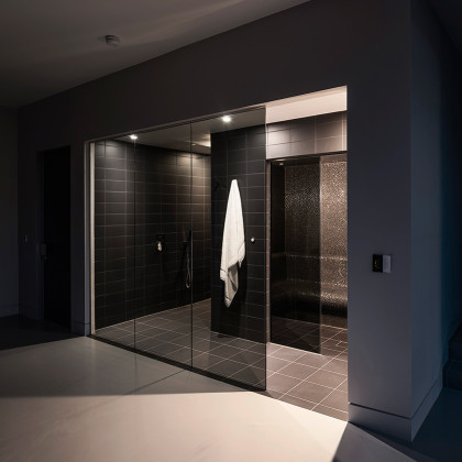 Ultra modern bathroom, large SSI Frameless Walk-In shower screen to ceiling, installed in a luxury wet room.