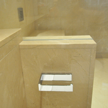 SSI frameless enclosure to ceiling, recess wall channels, close up of corner cut in glass, luxury wet room bathroom in London
