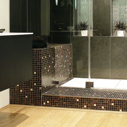 SSI frameless enclosure to ceiling, close up of corner cut in glass, luxury wet room loft bathroom in London