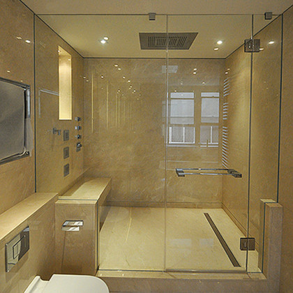 SSI frameless enclosure to ceiling, recess wall channels and corner cut in glass,luxury wet room bathroom in London