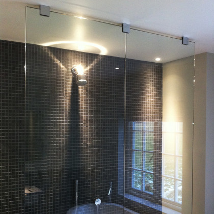 SSI frameless walk-in shower screen made in two pieces due to access problems and UV bonded inline. Luxury bathroom in London
