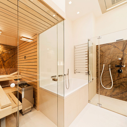 Architect designed wet room bathroom with an SSI frameless shower enclosure at side of bath, installed in a house in London